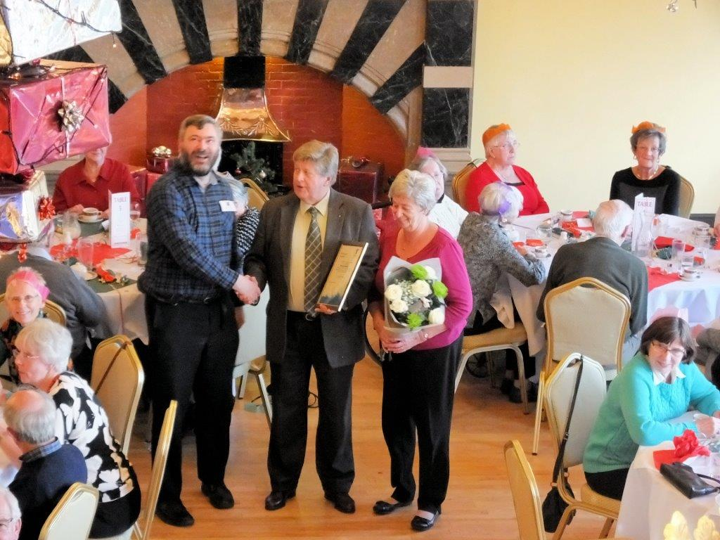 Richard May (left) presenting Stuart with his certificate. Stuart's wife, Evelyn, is on the right.